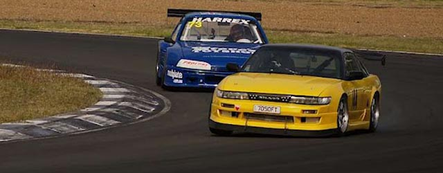 A battle in the Sports Sedan/Touring Car race at Queensland Raceway's Shannons 2 Days of Thunder