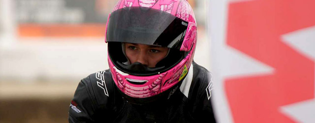 Brandon Demmery, sporting his distinctive pink helmet sits in Pit Lane at Queensland Raceway