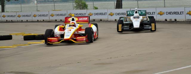 Helio Castroneves leads Ed Carpenter at the Belle Isle street circuit