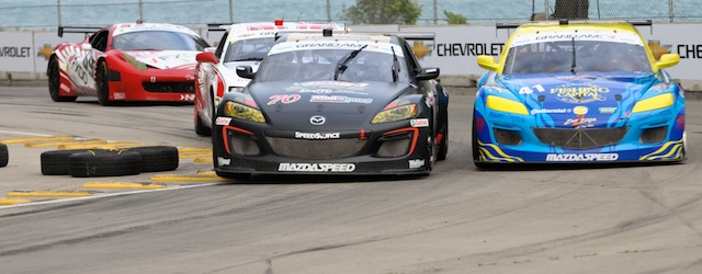 The Mazda RX8s battle in the GT Class of the Grand Am race at Detroit