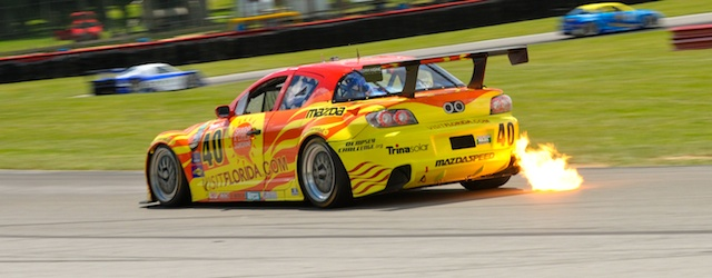 The Dempsey Racing Mazda RX-8 spits flame at Mid Ohio