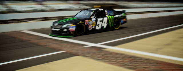 The Kyle Busch Motorsports #54 Monster Toyota Camry crosses Indy's famous yard of bricks