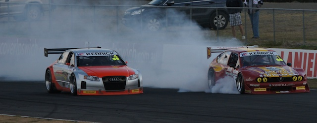 Tony Ricciardello locks up as he defends against  Darren Hossack at Queensland Raceway