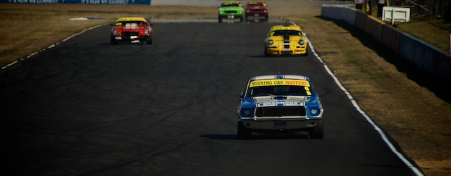 The Touring Car Masters race down Queensland Raceway's back straight