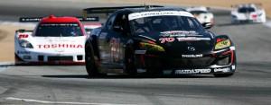 The Speedsource Mazda leads the Suntrust Chevrolet at Laguna Seca
