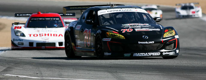 The Speedsource Mazda leads the Suntrust Chevrolet at Laguna Seca