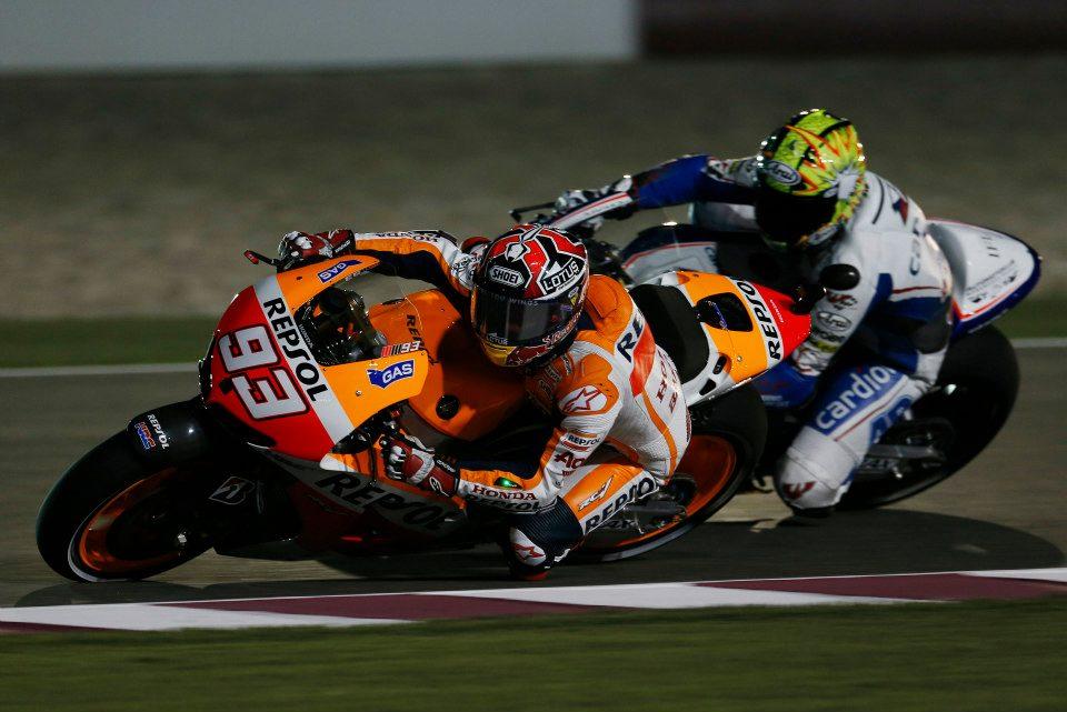 MotoGP hotshoe Marc Marquez passes Karel Abraham's CRT machine (photo: Honda Racing)