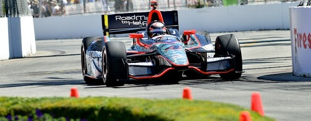 The Panther Racing Dallara picks its way through the streets (Jim Fonseca)