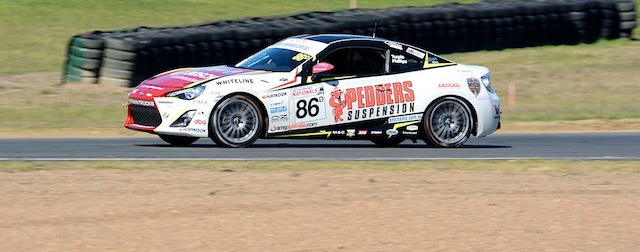 The Toyota 86 rounds the final corner at QR