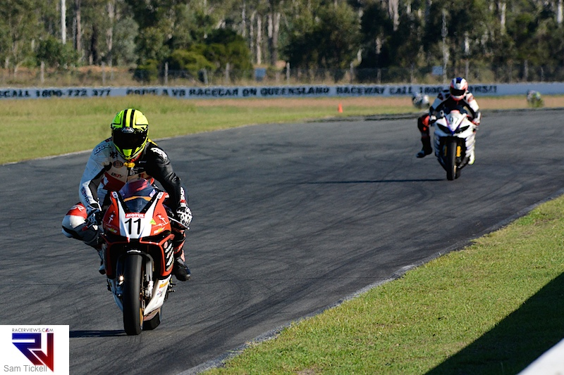 Phil Czaj races down the back straight at Queensland Raceway