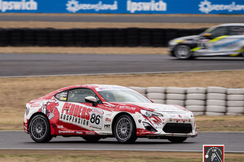 Pedders Racing's Grant Phillips and Andrew Turpie took out a class win and podium at Queensland Raceway