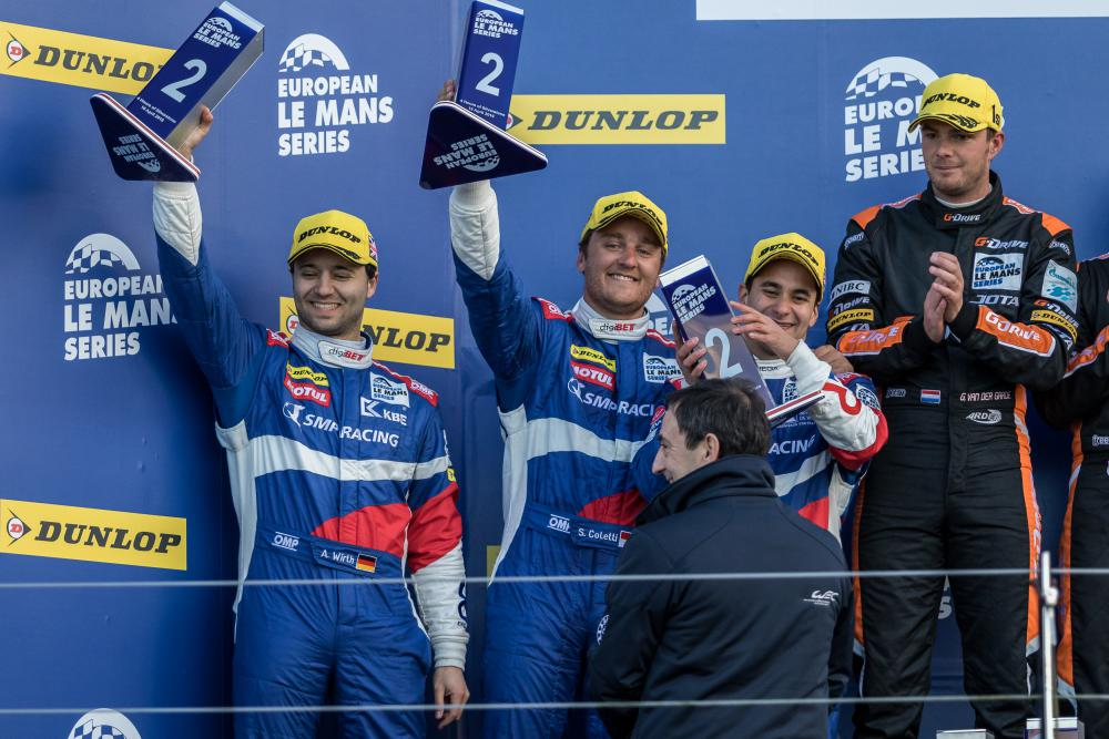 Andreas Wirth (Far left) celebrates with his SMP Racing teammates