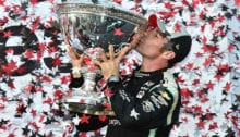 09-19-pagenaud-kisses-trophy-son