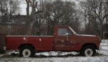 An older Ford F-250 pick-up truck with rust spots sits in the yard of a home in Detroit, Michigan January 8, 2015. Detroit, also known as the Motor City, is the historic hub of automobile manufacturing in the United States. A federal judge in December 2013 formally declared the city bankrupt but it won court approval to exit bankruptcy last November. Once the proud symbol of U.S. industrial strength, Detroit fell on hard times after decades of population loss, rampant debt and financial mismanagement left it struggling to provide basic services to residents. The Detroit car show, formally the North American International Auto Show, is being held for the 26th year and represents the turn in the city's fortune with 2014 being the best year for U.S. car sales since 2006. Reuters photographer Joshua Lott documented old or damaged cars, a common element in a series of cityscapes in the former automobile industry giant.      REUTERS/Joshua Lott (UNITED STATES - Tags: TRANSPORT BUSINESS CITYSCAPE SOCIETY)  ATTENTION EDITORS: PICTURE 10 OF 16 FOR WIDER IMAGE PACKAGE 'WRECKED IN DETROIT'  TO FIND ALL IMAGES SEARCH 'CITYSCAPES LOTT' - RTR4L8U2