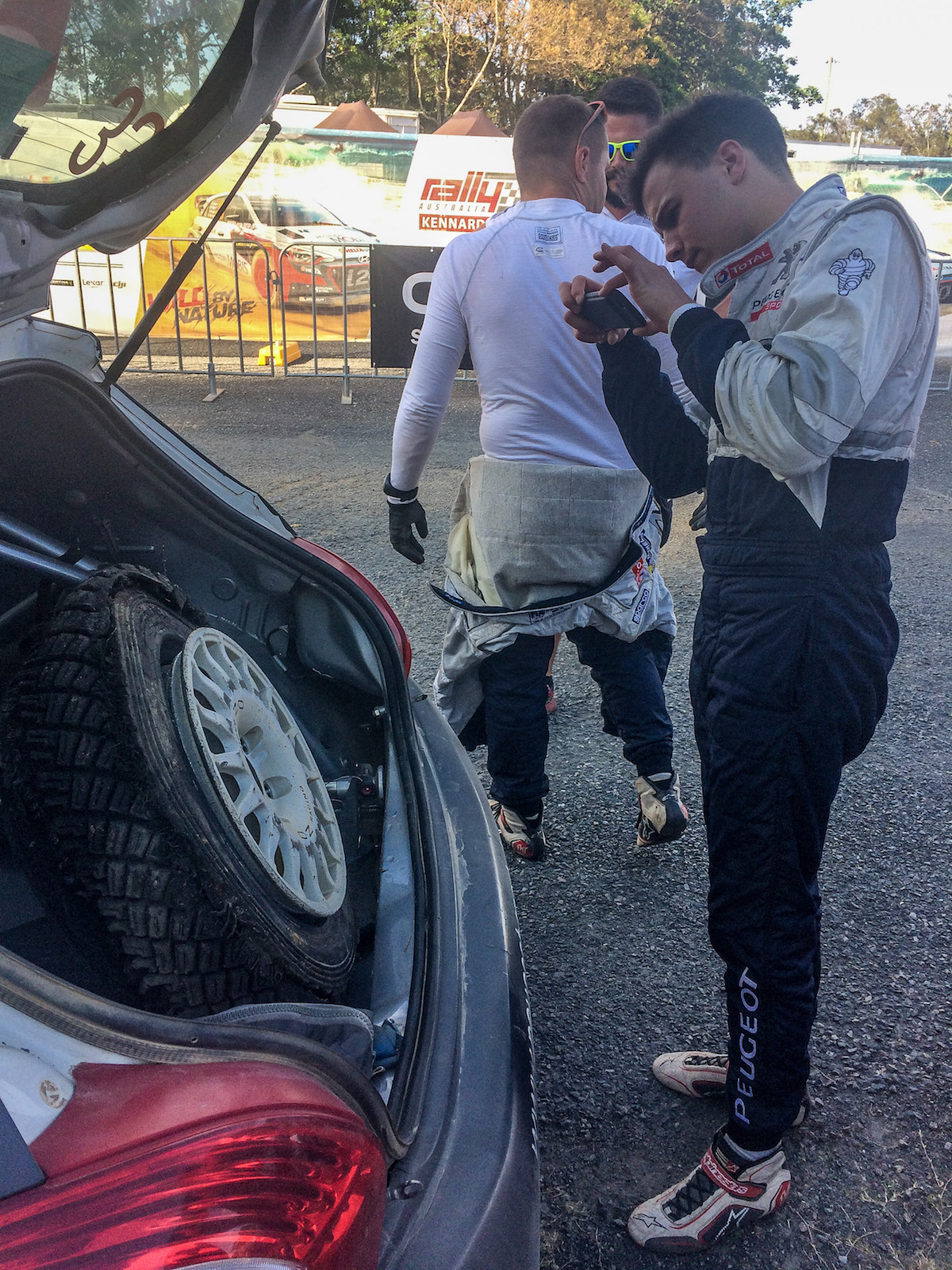 Hubert Ptaszek looks at a damaged tyre on the way to a podium in Rally Australia // Photo: Sam Tickell //